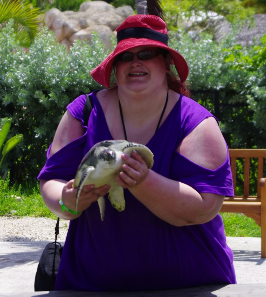 Holding a sea turtle on Grand Cayman