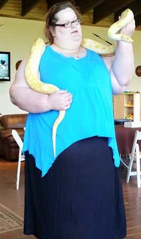 I look like hell, but still, I'm holding a huge snake